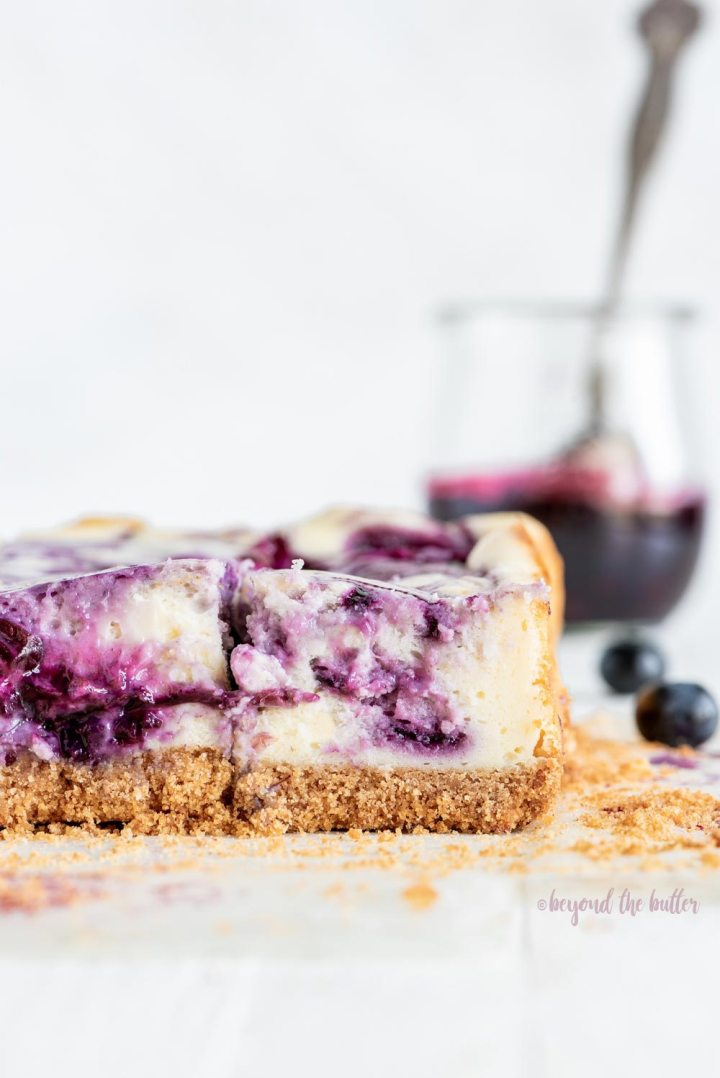 Blueberry Swirl Cheesecake Bars | Image of blueberry swirl cheesecake bars | Image and Copyright Policy: © Beyond the Butter, LLC