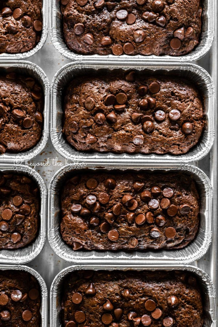 Overhead image of mini chocolate zucchini bread loaves | All Images © Beyond the Butter™