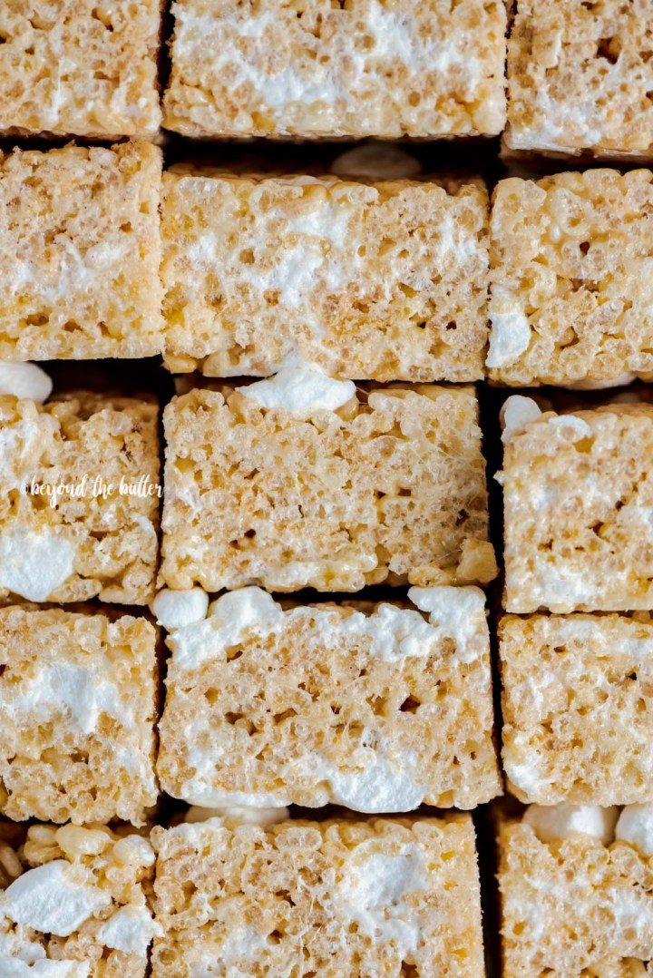 Overhead closeup image of the best rice krispie treats stacked and on their side | All Images © Beyond the Butter™