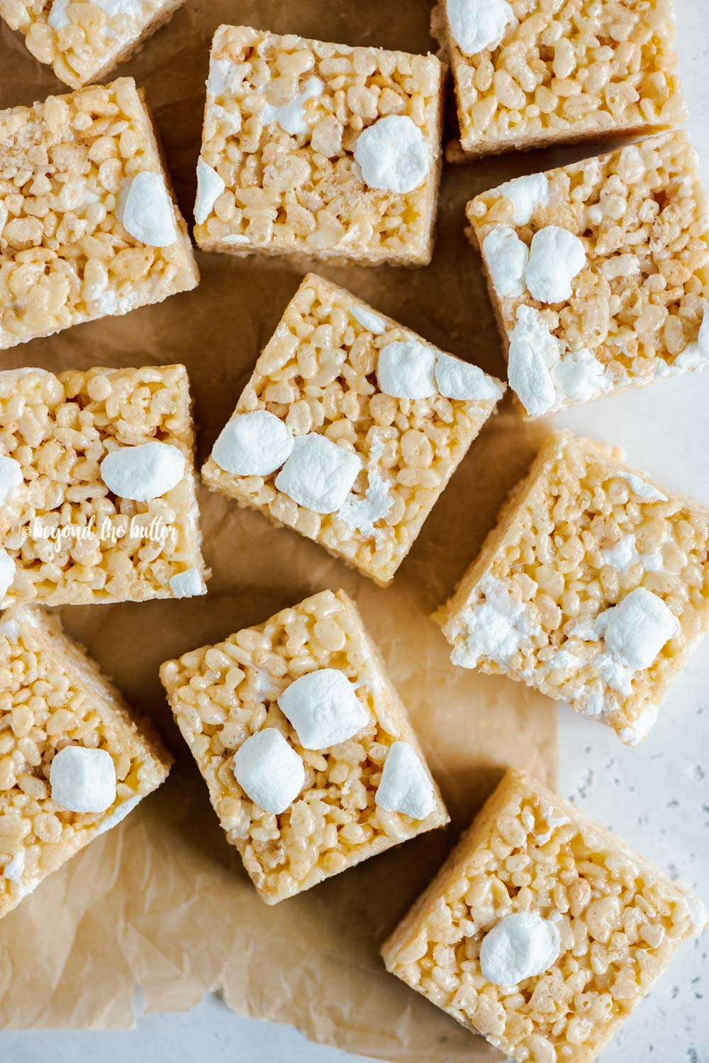 Overhead image of the best rice krispie treats on parchment paper | All Images © Beyond the Butter™