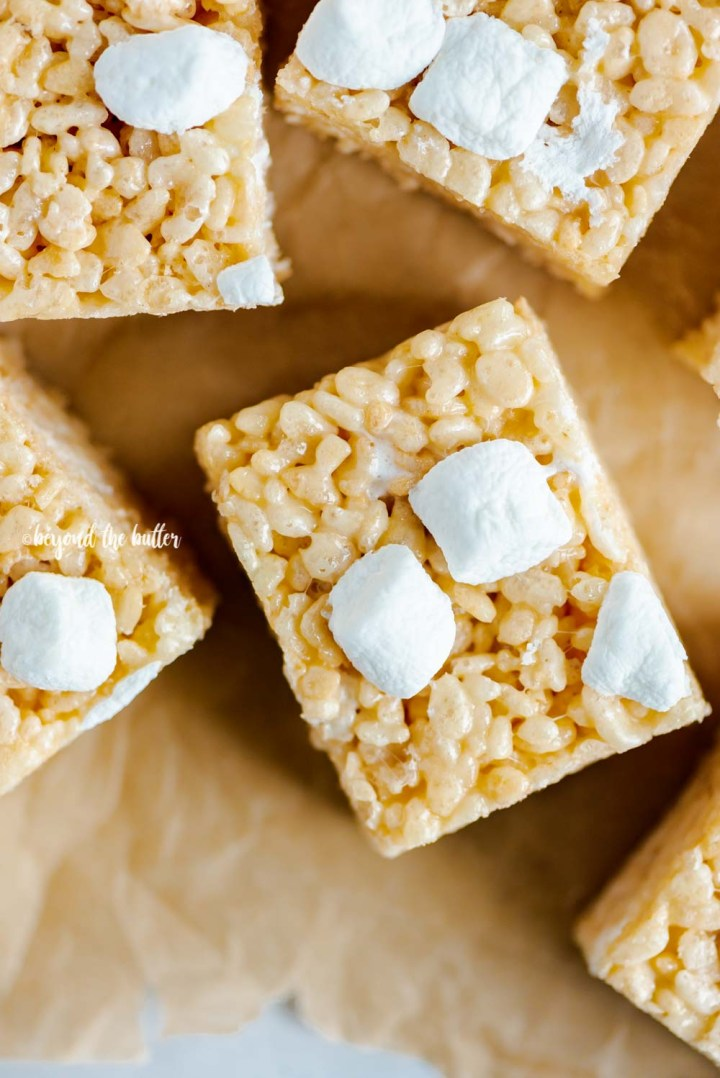 Overhead closeup image of the best rice krispie treats on parchment paper | All Images © Beyond the Butter™