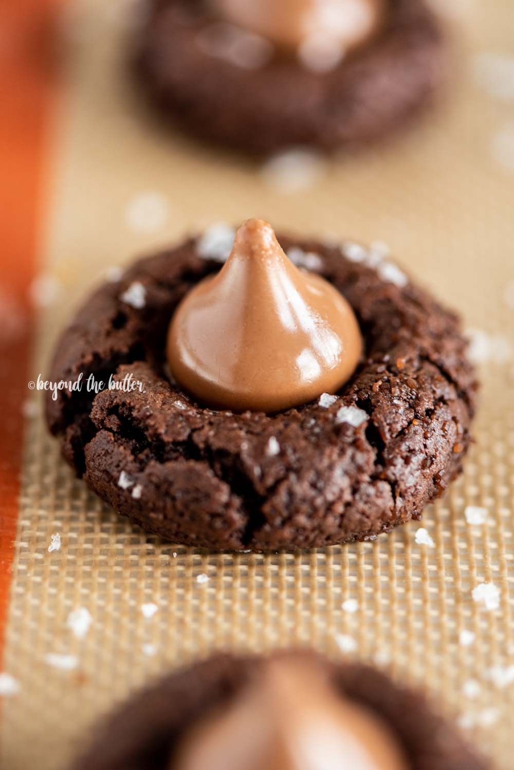 Angled image of Chocolate Caramel Blossoms on cookie sheet | All Images © Beyond the Butter, LLC