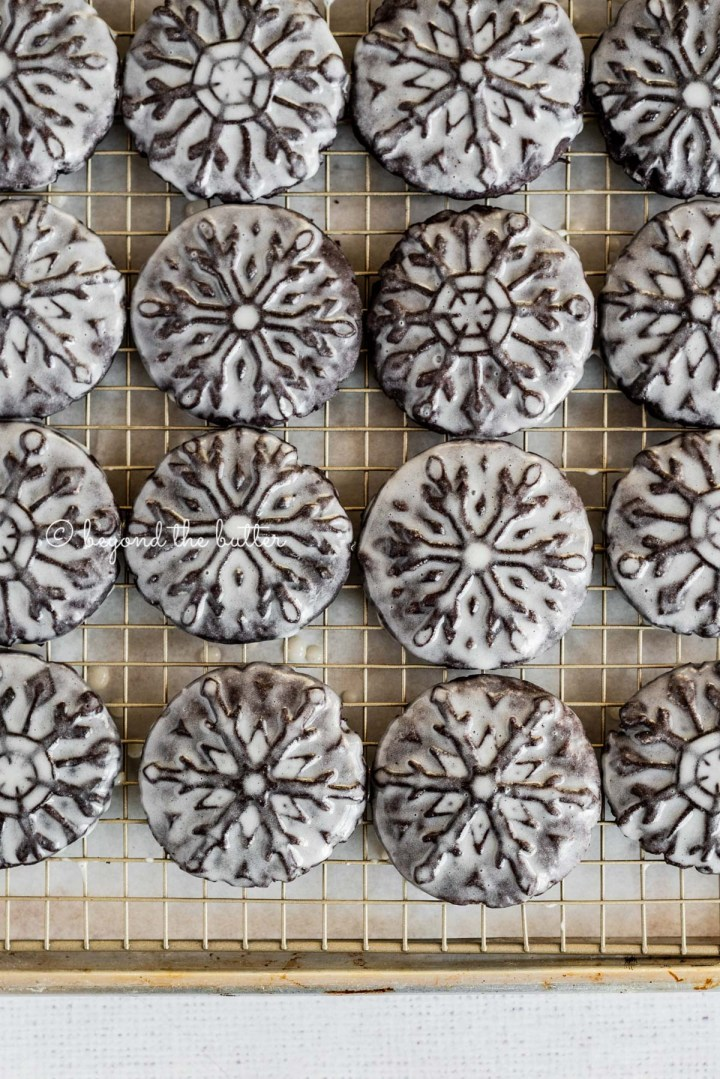 Overhead image of homemade oreo snowflake cookies on a wire cooling rack | All Images © Beyond the Butter®