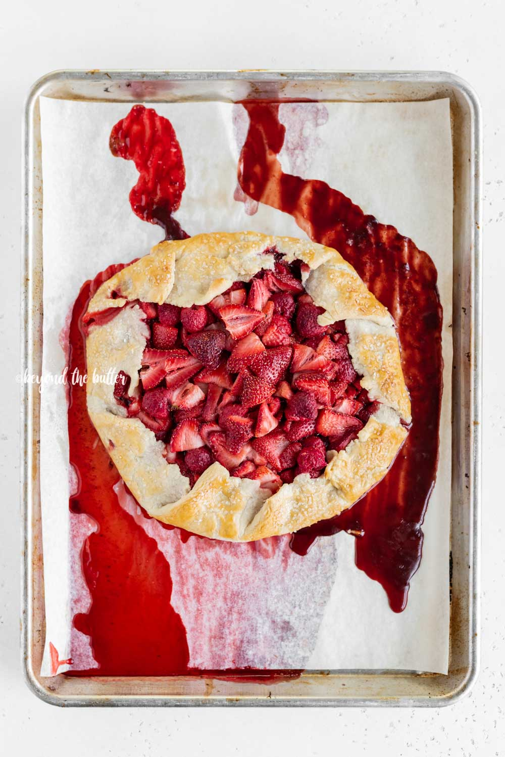 Overhead image of freshly made Berry Nutella Galette on a baking sheet | All Images © Beyond the Butter™