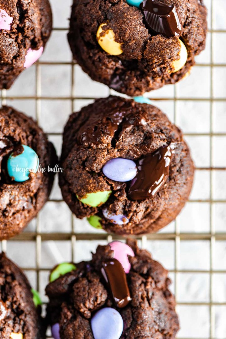 Closeup overhead image of double chocolate chunk cookies on a wire cooling rack | All Images © Beyond the Butter™
