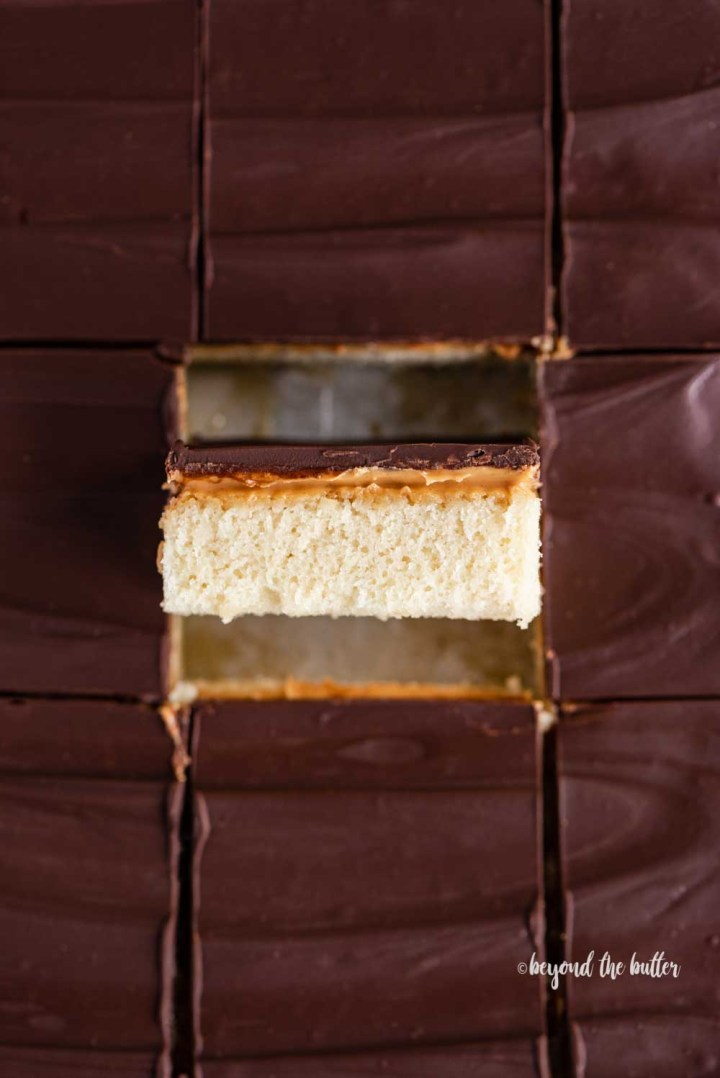 Closeup overhead image of cut irresistible peanut butter tandy kakes with one showing the side view | All Images © Beyond the Butter™
