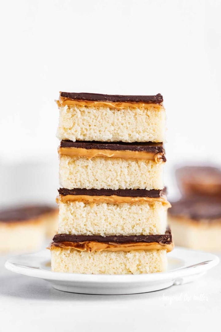 Image of stacked homemade peanut butter kandy kakes on a white dessert plate | All Images © Beyond the Butter™