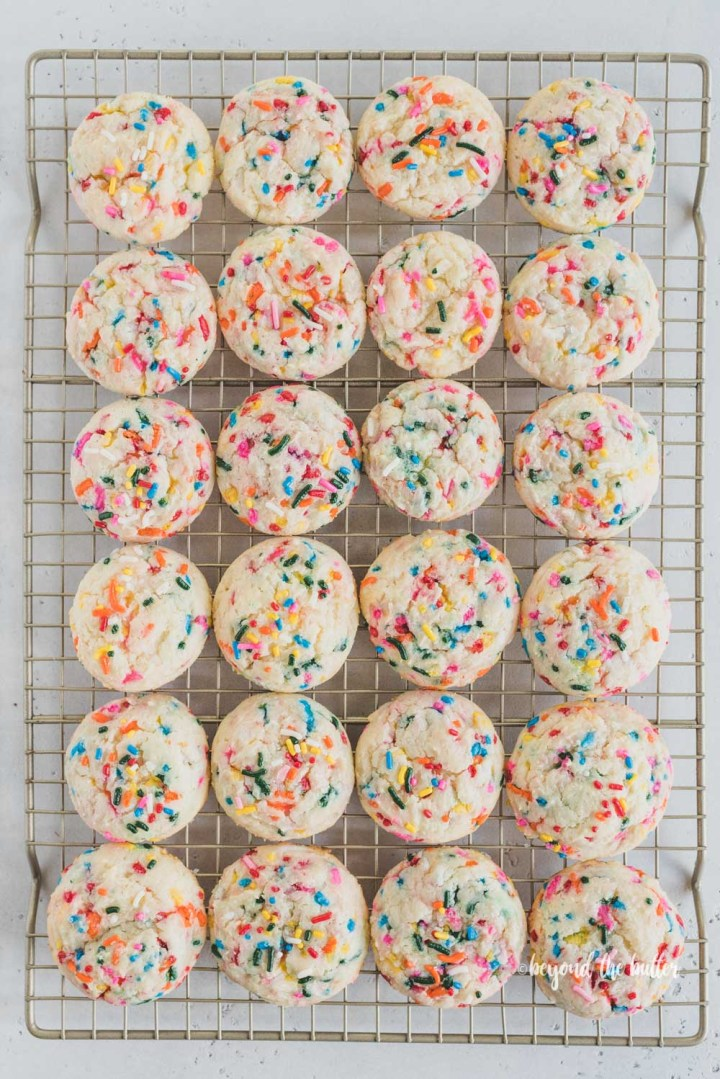 funfetti gooey butter cookies on a wire cooling rack | All Images © Beyond the Butter™