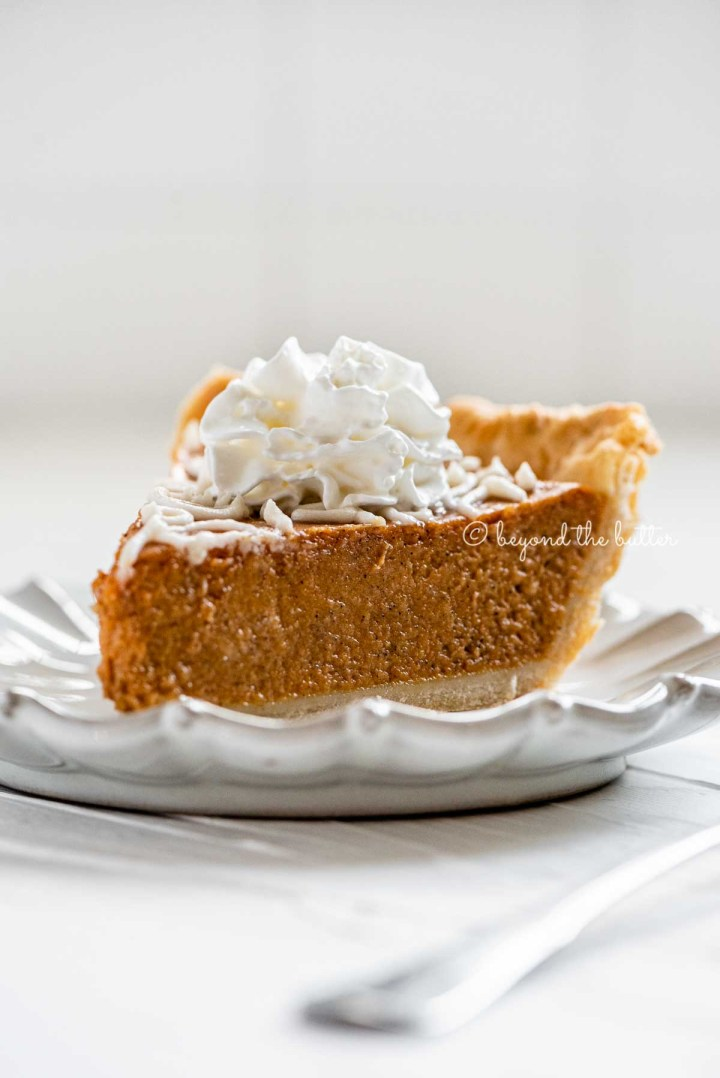 Slice of pumpkin pie on a dessert plate | All Images © Beyond the Butter™
