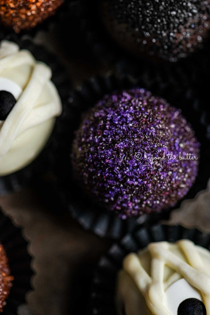 Closeup of Halloween Chocolate Truffles on dark brown background | All Images © Beyond the Butter™