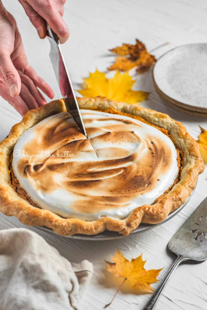 Cutting into the brown sugar sweet potato pie with pie server, plates, and napkin around it | | All Images © Beyond the Butter®