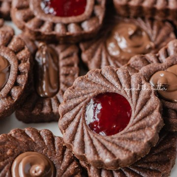 Closeup image of chocolate thumbprint cookies | All Images © Beyond the Butter®