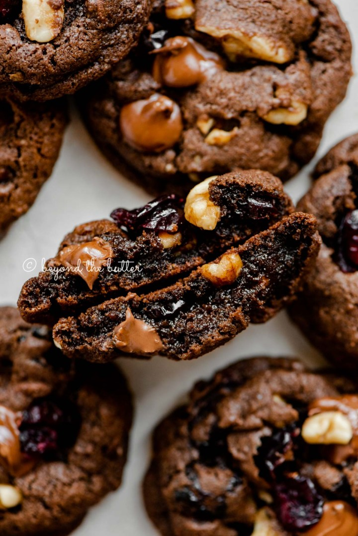 Dark chocolate cranberry walnut cookie split in half to see the inside | All Images © Beyond the Butter®
