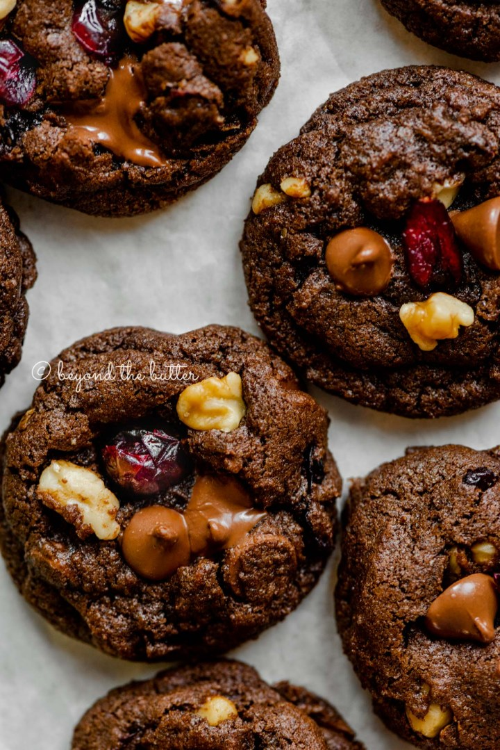 Dark chocolate cranberry walnut cookies on light gray background | All Images © Beyond the Butter®