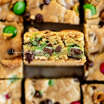 Close up image of easy holiday chocolate chip cookie bars cut into squares | All Images © Beyond the Butter®
