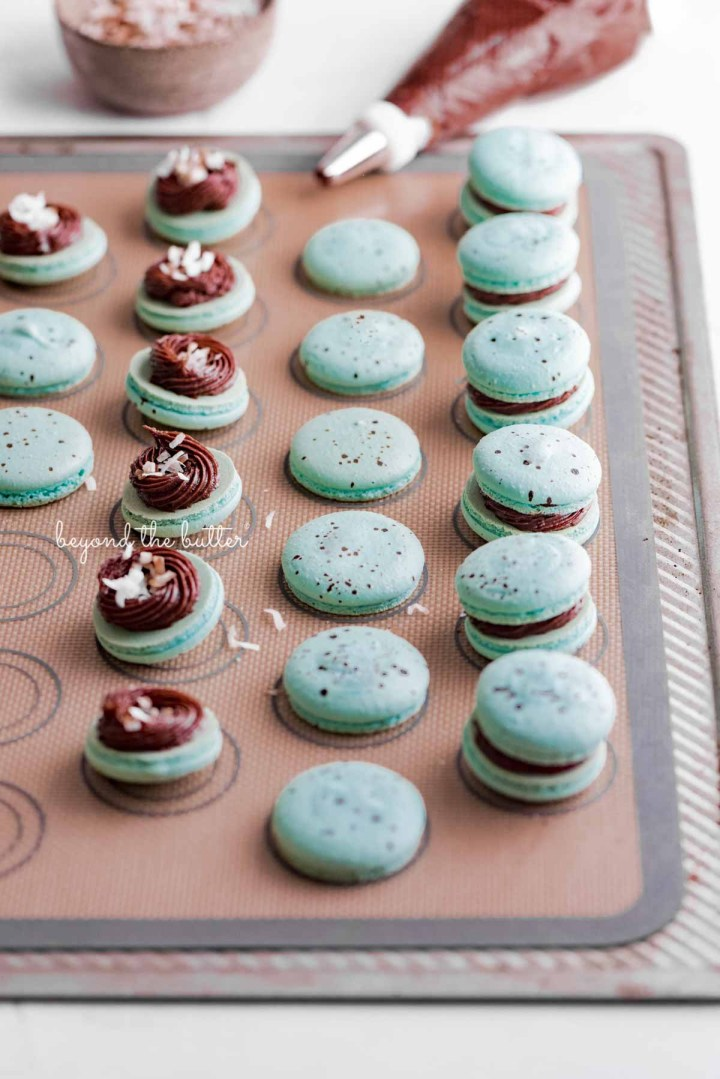 Assembling the robin's egg macarons on a silicone baking mat | All images © Beyond the Butter®