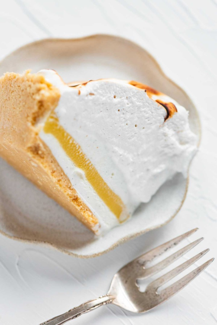 Slice of lemon meringue ice cream pie on its side from BeyondtheButter.com | ©Beyond the Butter®