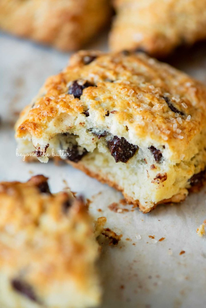 Halved chocolate chip scone on parchment paper lined baking sheet   © Beyond the Butter®