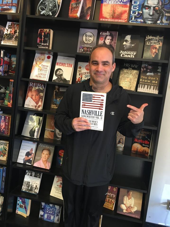 Jake Brown holding his book Nashville Songwriter Vol. II