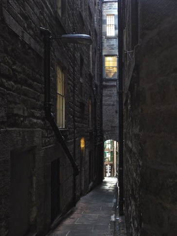 Sunlight barely reaches into this narrow Edinburgh passage.