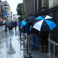 Rainy day queue by Notre Dame