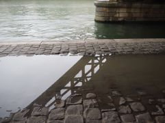 Puddle reflections by the Seine