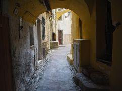 Through a yellow arch in Ventimiglia, April