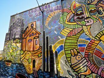 Odyssey of the 21st Century - a mural by DaCruz in December 2015 - part of Climat au Pied du Mur