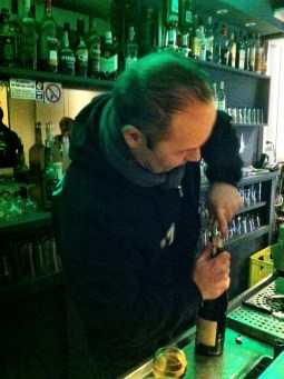 Les Pieton bar owner popping another cork of Beaujolais Nouveau
