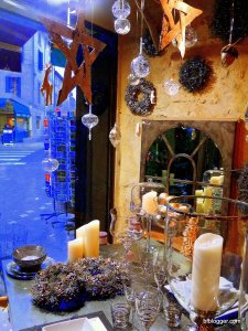Table toppers and other festive decorations fill store windows at Atzana