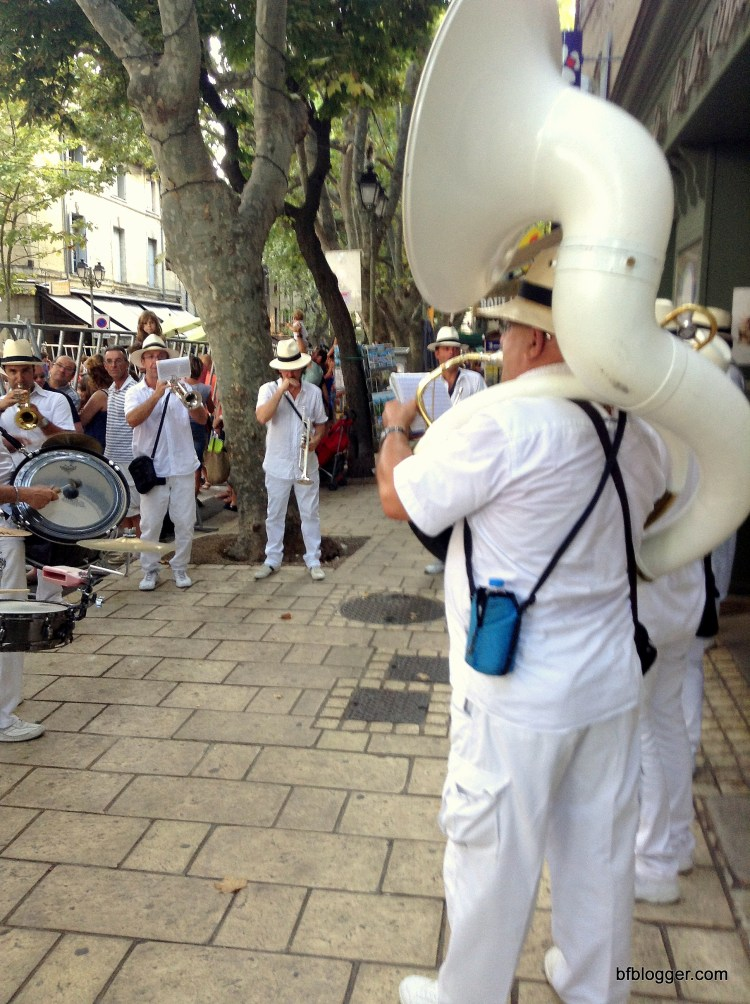 Brass Bands on the sidewalks.