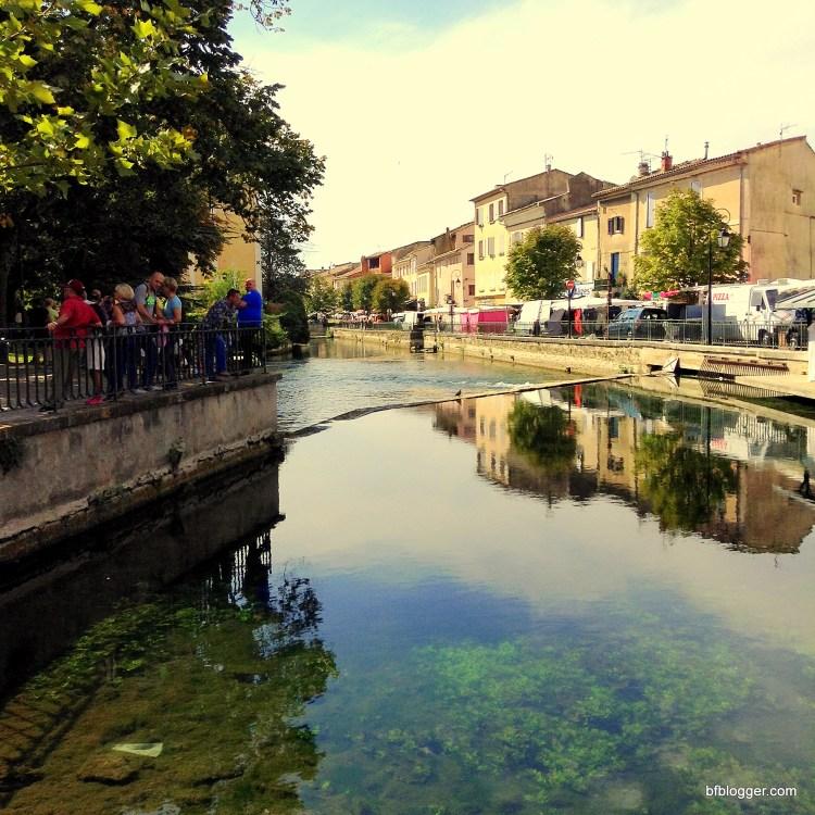 Canals snake through L'Isle Sur la Sorgue enhancing its charm