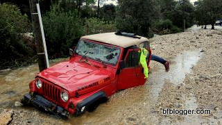 Car stranded by flood waters in Nimes