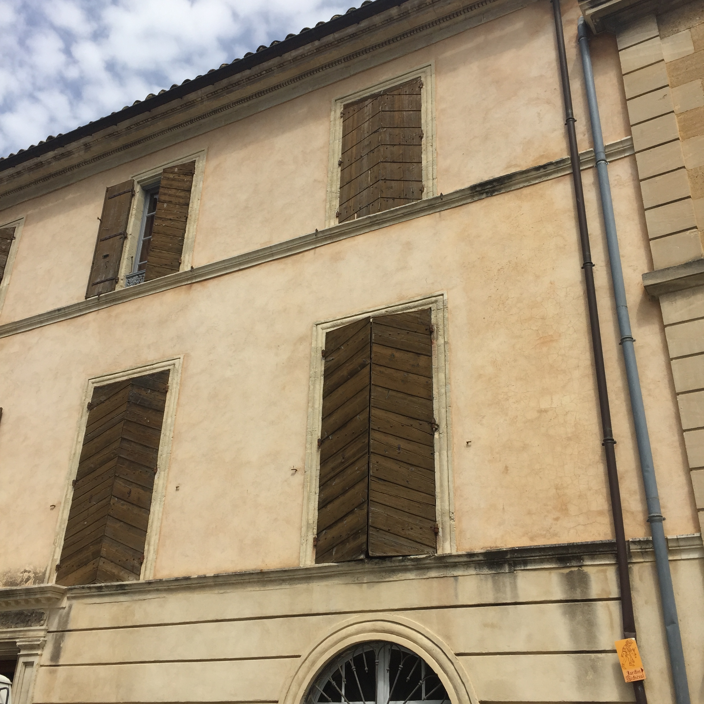 Shuttered windows in Uzes keep insides cooler in the summer