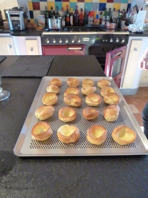 Tiny Yorkshire Puddings readied for roast beef topping