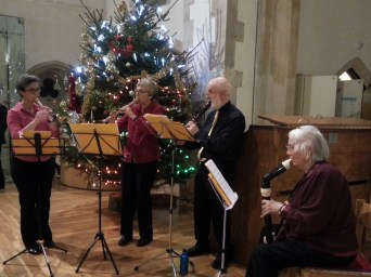 the recorder quartet playing Christmas music as guests arrived.