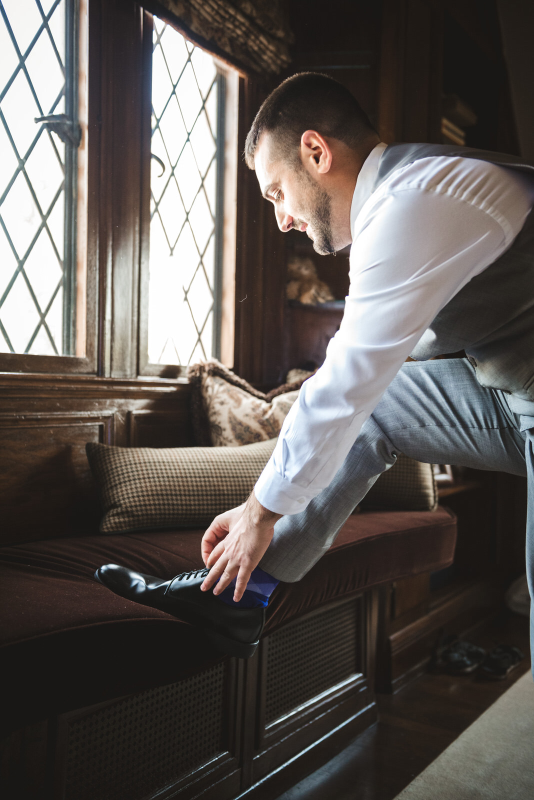 groom getting ready in Zenner House Athens Ohio