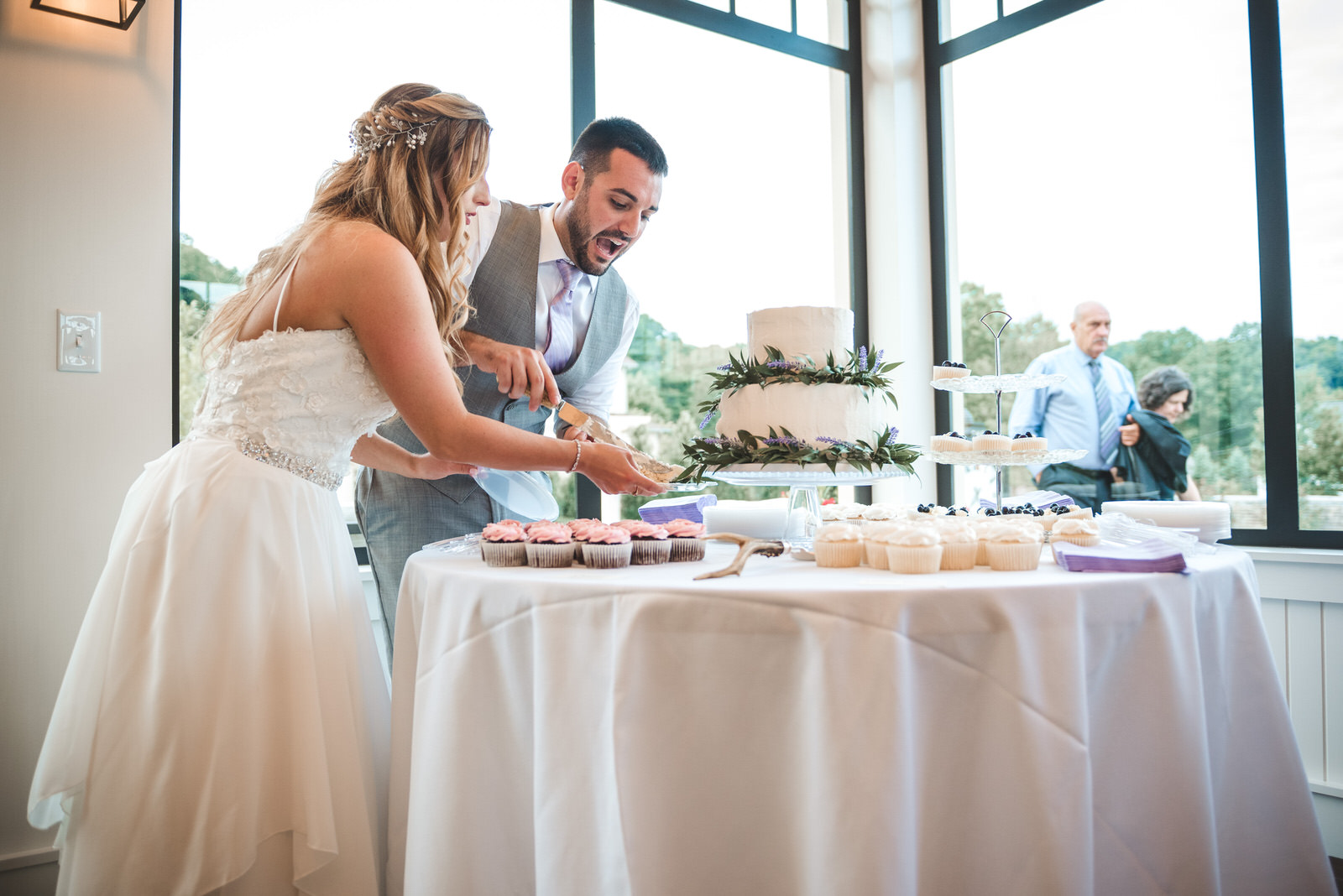 groom excited about cake cutting in Athens Ohio