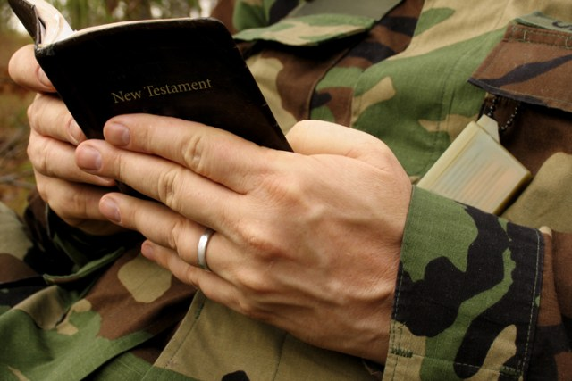 military man reading Bible - Billy Graham Daily Devotional