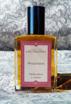 Antoinette, Sweet Tea Apothecary. 15 year old Marie Antoinette was a bit surprised when she arrived at Versailles – instead of the grand imperial palace of the Sun King, Louis XIV, the royal halls were in disrepair and the French court at the time was a bit less than what she'd call hygienic. Feminine and beautiful, the young Dauphine was France's biggest trendsetter with sky-high coiffures and daring gowns. She put her womanly touch on the palace, helping with extensive redecoration to bring Versailles back to its original glory. She spent many hours in the gardens of the Trianon and at her idyllic, pastoral Hameau de la Reine (a thirty minute or so walk from the palace). It is no surprise that she enjoyed the smell of fresh florals. La Reine Antoinette is inspired by the actual perfume worn by France's most famous queen. Gentle notes of Rose, Bergamot, and Jasmine accented by fresh moss will make you feel as though you're picking wildflowers in the gardens of Versailles.
