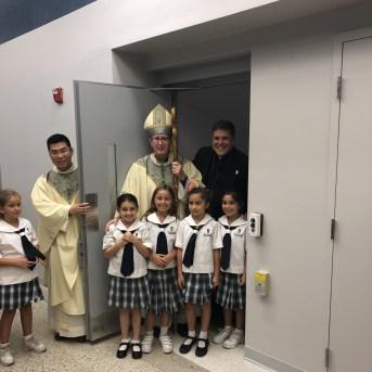 Bishop with school kids