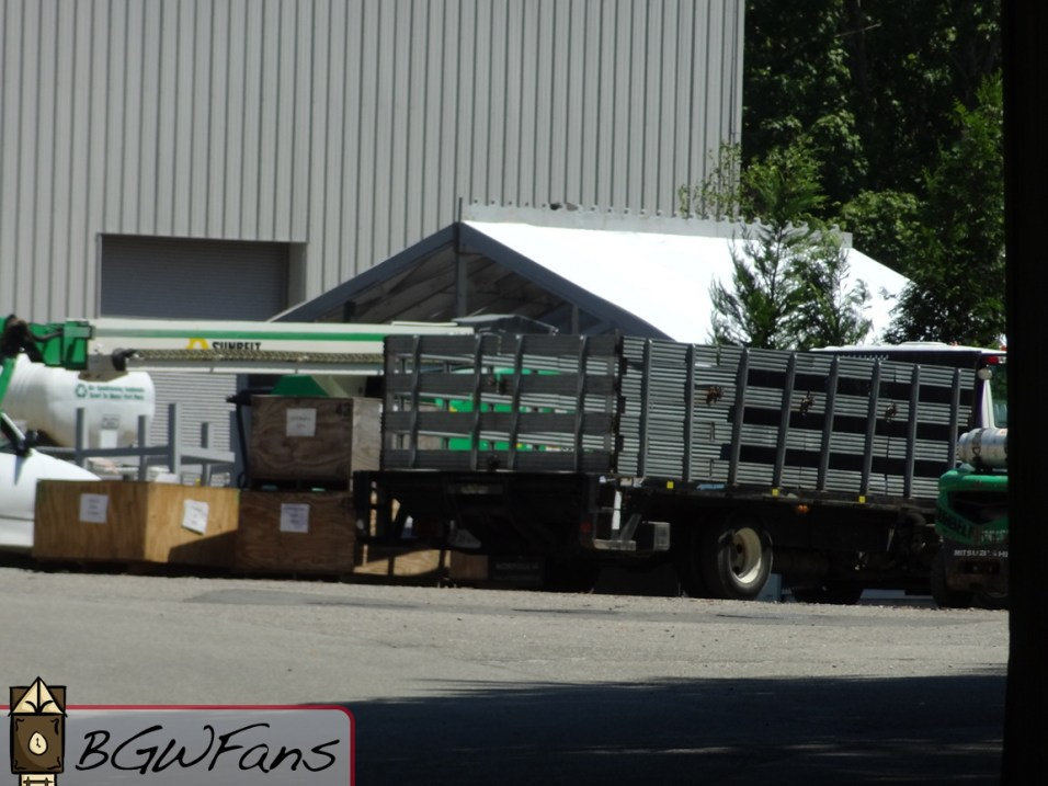 Crates, trucks, and a greenhouse roof