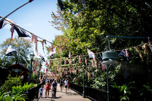 Lots of fabric, rats, and other stuff hanging along the bridge