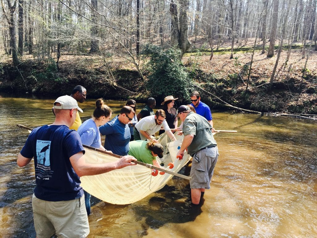 "Sustainability leaders get their feet wet ""chasing"" fish in the Cahaba watershed"