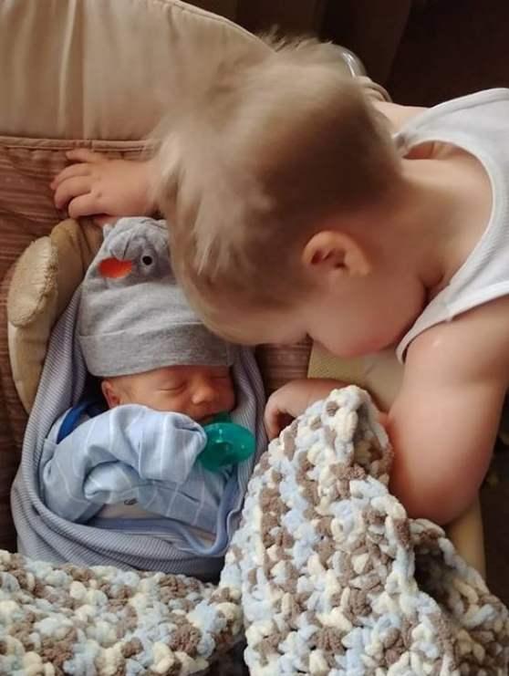 Gabriel and newborn Micah