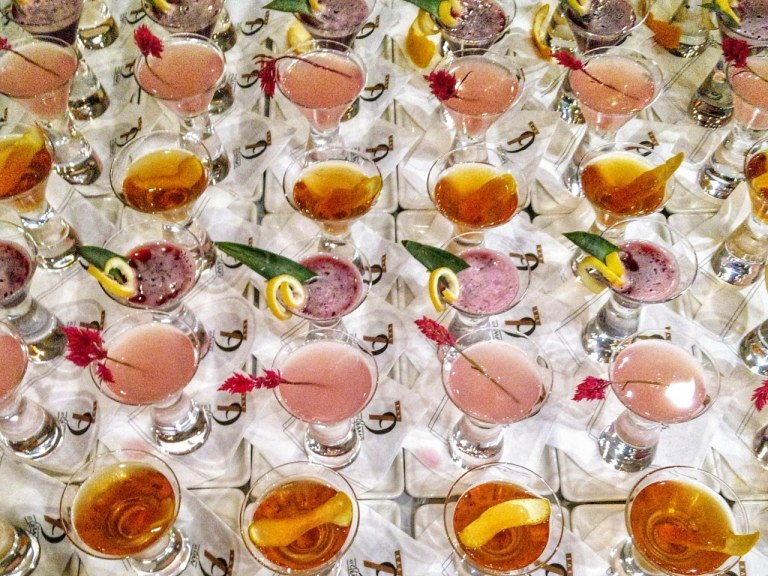 table full of brightly colored cocktails