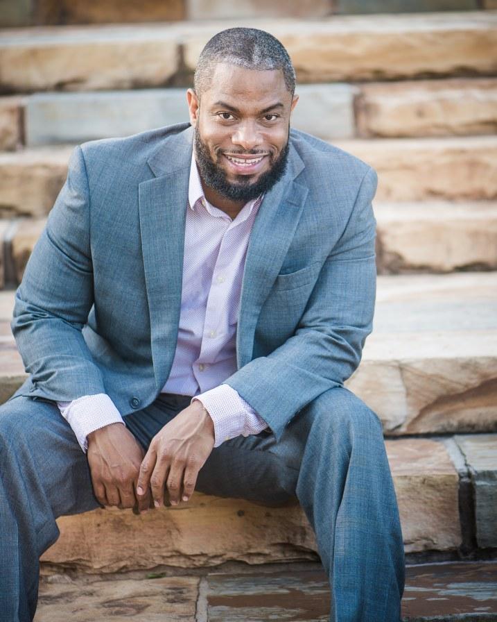 Portrait of Daryl Harris, founder of Moovmo, sitting on steps in Birmingham, Alabama