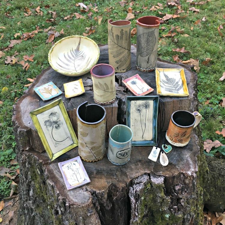 One of the Roebuck Springs potters, Shelleigh Buckingham, displayed selected works in her back yard where she finds leaves to press into the clay.