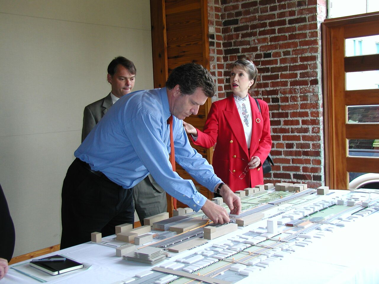 Giles and others looking at an early model of Railroad Park.
