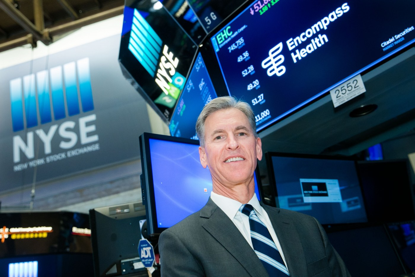 Encompass Health Corporation (NYSE:EHC) visits the New York Stock Exchange (NYSE) to highlight their rebrand and name change from HealthSouth. To mark the occasion President & CEO, Mark Tarr, rings The Closing Bell®. (Encompass Health)